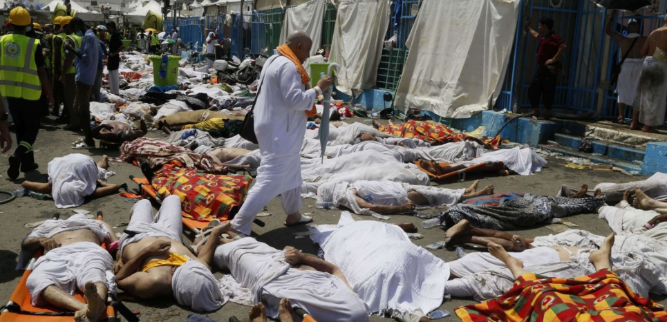 A muslim pilgrim walks through the site where the victims of a stampede are gathered in Mina, Saudi Arabia during the annual hajj pilgrimage on Thursday, Sept. 24, 2015. Hundreds were killed and injured, Saudi authorities said. The crush happened in Mina, a large valley about five kilometers (three miles) from the holy city of Mecca that has been the site of hajj stampedes in years past. (AP Photo)/CAIMA/317516814796/1509241420